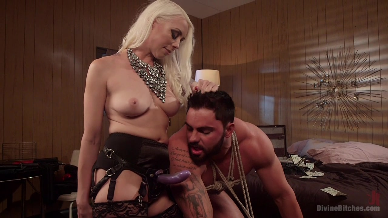 Mommy uses the strap-on toy on her male slave's tight ass