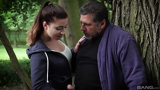 Outdoor fun in the park with a man much older than her